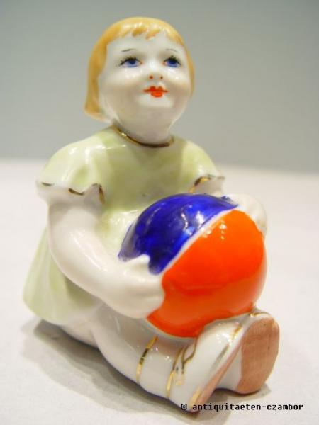 Sitting girl with ball, Russian, probably Dmitrowski porcelain, ca. 1930